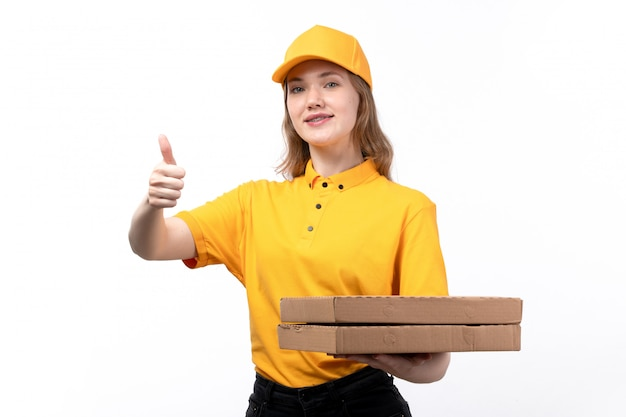 A front view young female courier female worker of food delivery service holding pizza boxes on white
