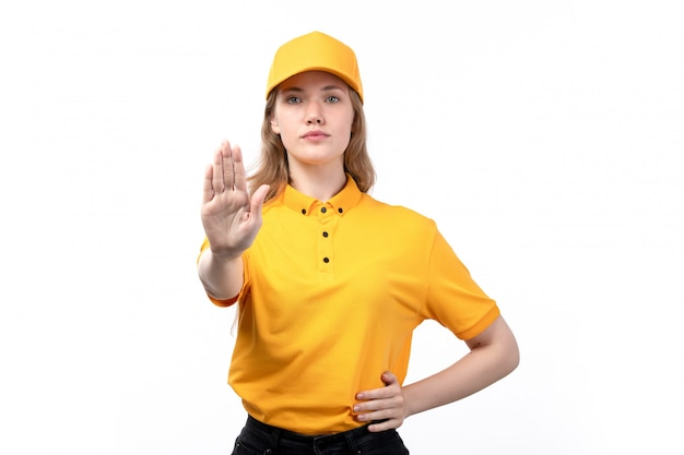 A front view young female courier female worker of food delivery service showing stop sign on white