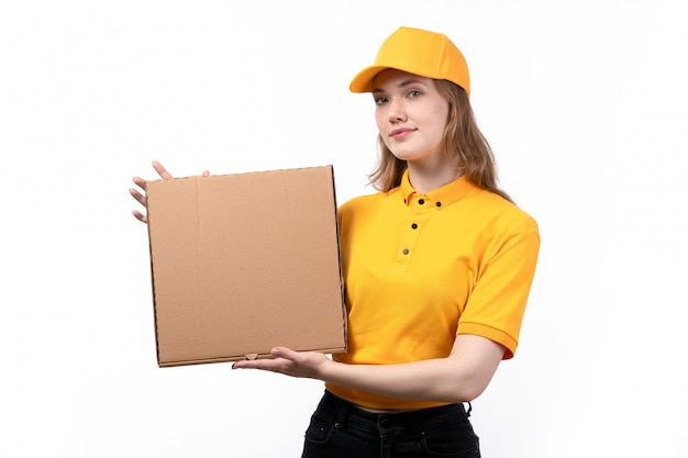 A front view young female courier female worker of food delivery service smiling holding delivery boxes on white