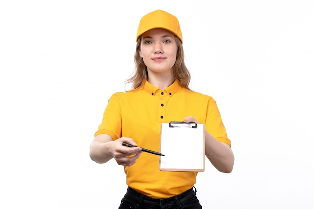 A front view young female courier female worker of food delivery service smiling holding notepad for signatures on white