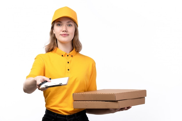 A front view young female courier female worker of food delivery service smiling holding pizza boxes and notepad on white