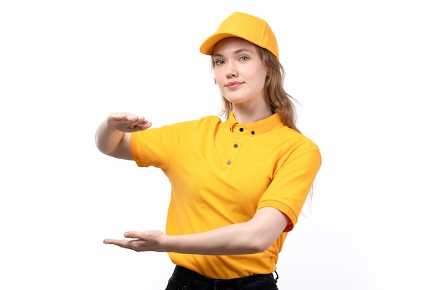 A front view young female courier female worker of food delivery service smiling showing size of delivery on white