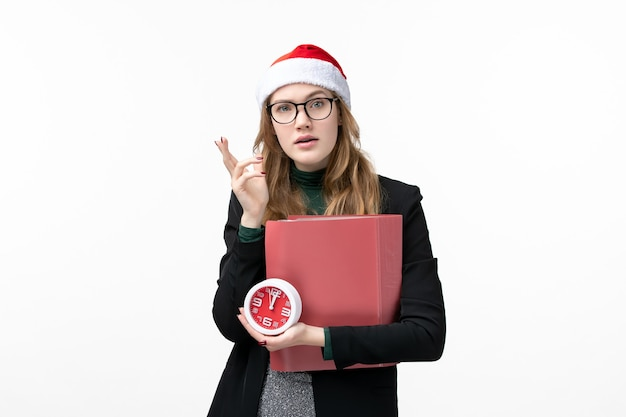 Front view young female holding clock and files on a white wall books lesson college