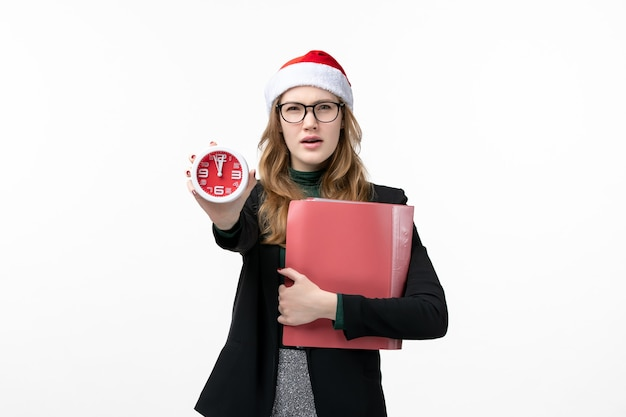 Front view young female holding files and clock on white wall book new year christmas