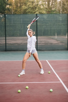 Front view young female playing tennis