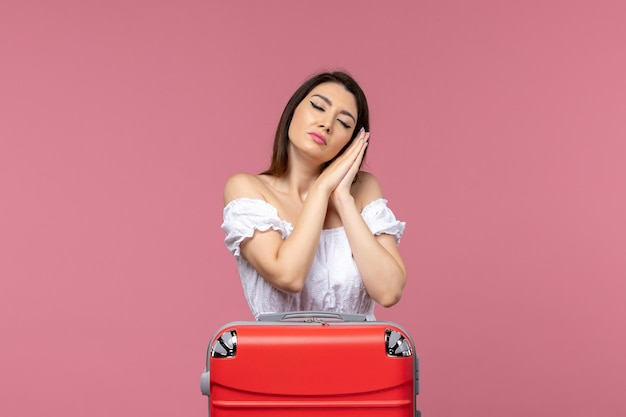 Front view young female preparing for vacation and feeling tired on pink background abroad sea journey travel trip voyage