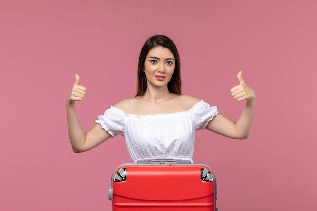 Front view young female preparing for vacation on light pink background vacation abroad travel trip voyage