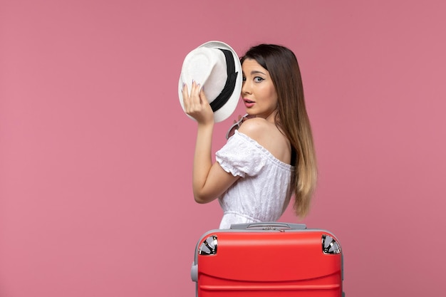 Front view young female preparing for vacation on light-pink background voyage trip journey abroad travel sea