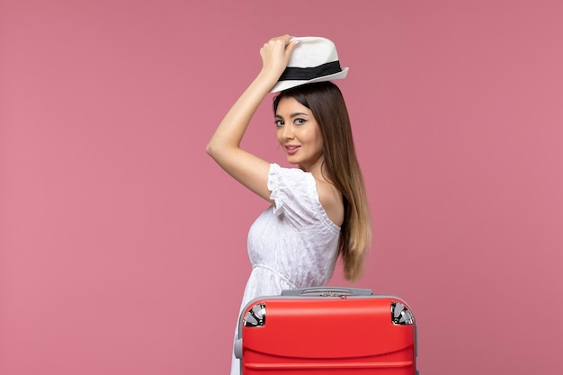 Front view young female preparing for vacation on light pink background voyage trip journey abroad travel sea