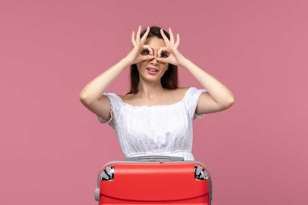 Front view young female preparing for vacation on pink background abroad trip sea journey travel voyage
