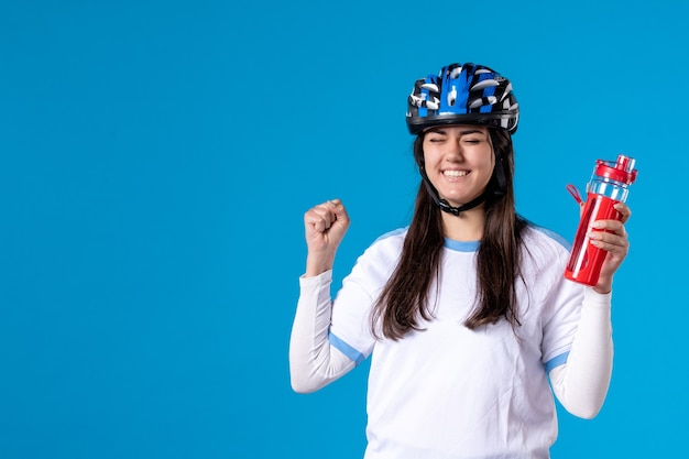 Front view young female in sport clothes and helmet