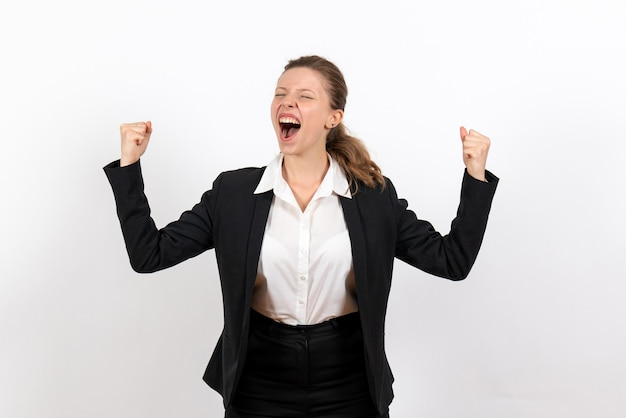 Front view young female in strict classic suit posing and rejoicing on white background job business costume woman work