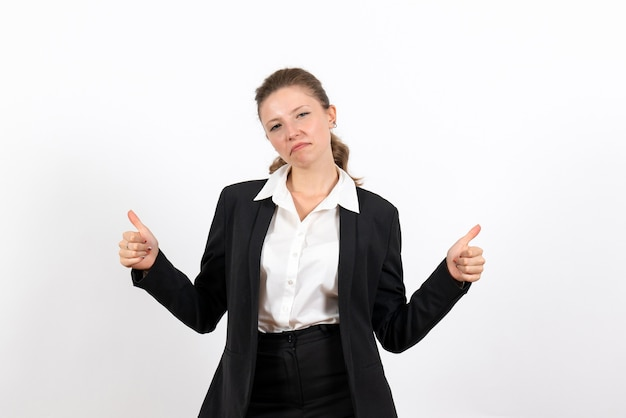 Front view young female in strict classic suit posing on the white background woman job business female work costume