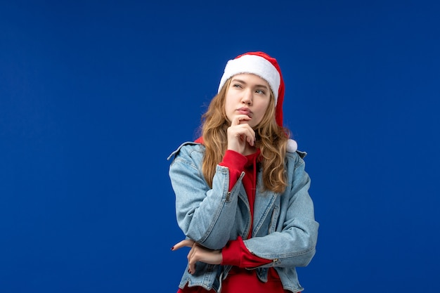 Front view young female thinking on blue background color emotion christmas holiday