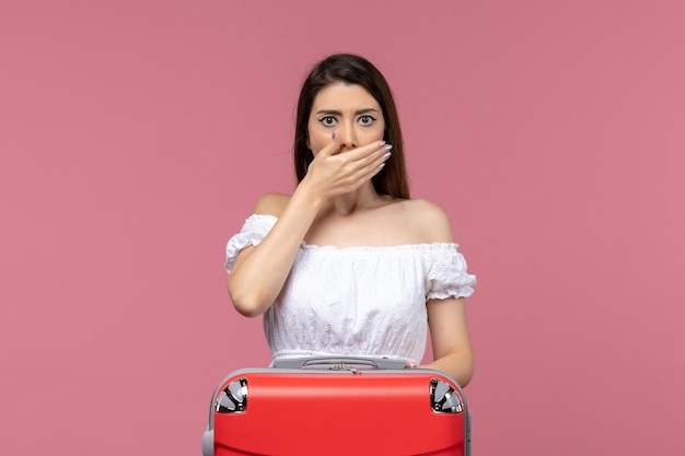 Front view young female in vacation covering her mouth on pink background abroad sea journey voyage travel trip