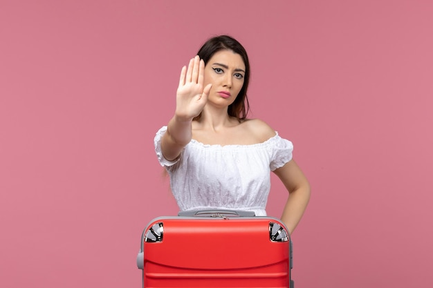 Front view young female in vacation with her bag on a pink background abroad sea journey travel trip voyage