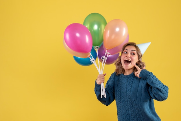 Front view young female with colorful balloons