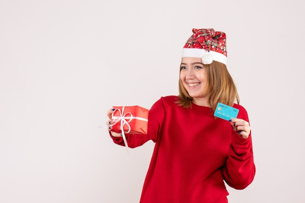 Front view young female with little xmas present and bank card