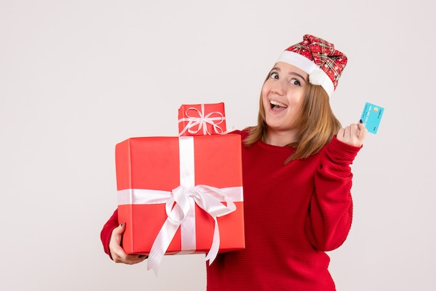 Front view young female with xmas presents and bank card