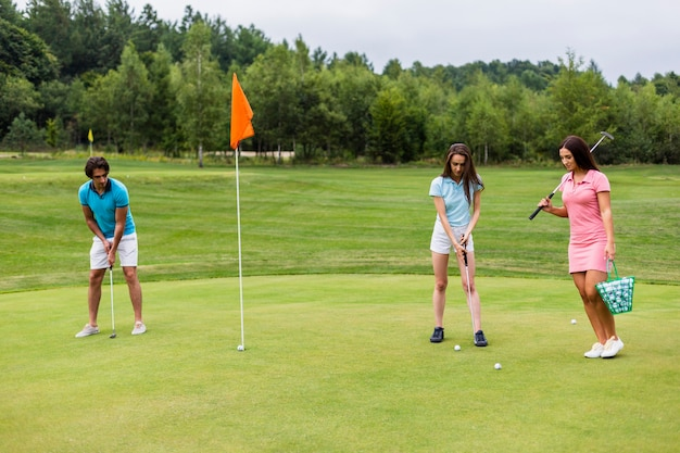 Front view of young golfers playing