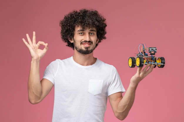 Front view young guy giving ok gesture to robotic innovation