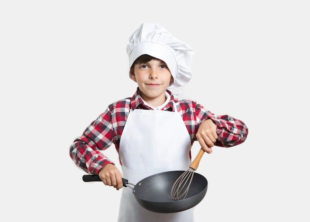 Front view young kid with a cooking pan