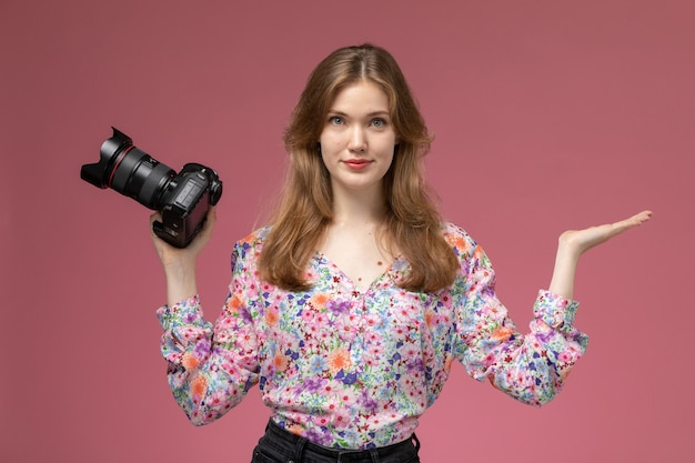 Front view young lady showing empty hand and photocamera