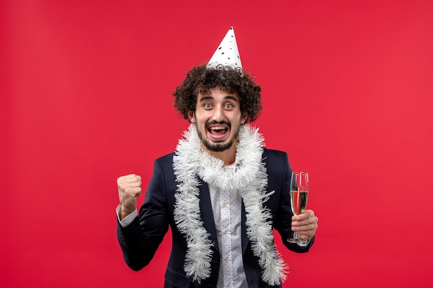 Front view young male celebrating another year on the red wall human holiday party