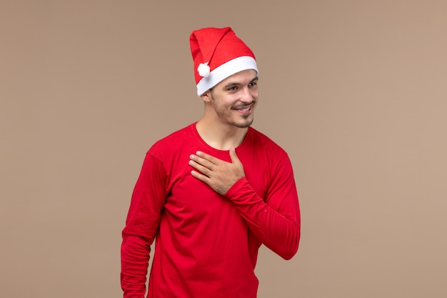 Front view young male greeting with someone on brown background christmas emotion holiday male