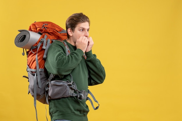 Front view young male with backpack preparing for hiking scared
