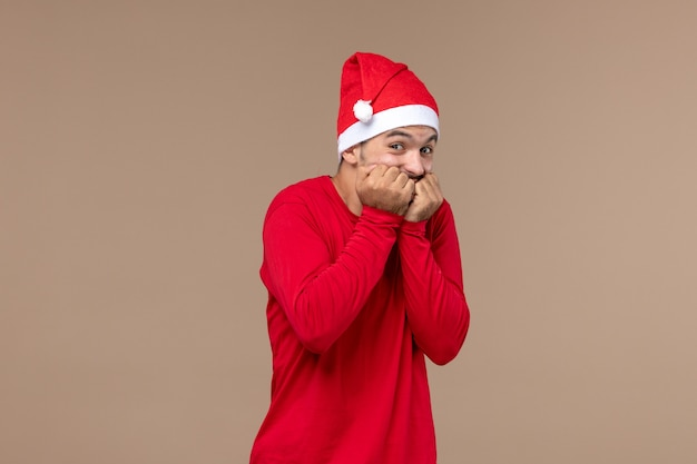 Front view young male with excited expression on a brown desk holiday male emotion
