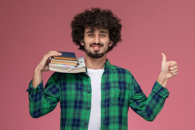 Front view young man thumbs up within exam week