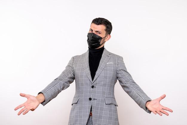 白い孤立した背景に立っている手を開く黒いマスクを持つ正面図
