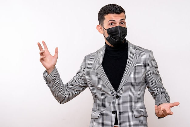 Front view young man with black mask opening hands standing on white isolated background