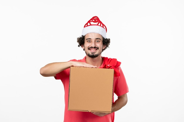Front view of young man with delivery food box on white wall