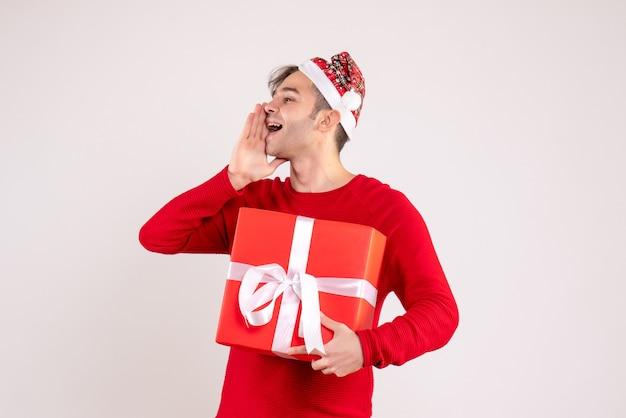 Front view young man with santa hat calling someone on white background