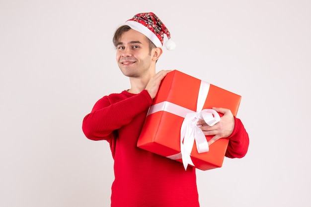 Front view young man with santa hat standing on white background