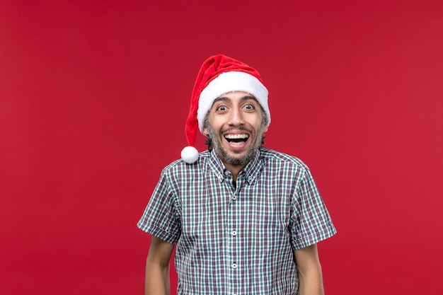 Front view young person with laughing expression on red wall red holiday new year