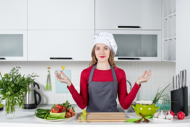 Front view young woman in apron making special hand gesture