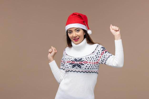 갈색 배경 크리스마스 새 해 감정에 춤 전면보기 젊은 여자