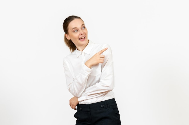 Front view young woman in elegant white blouse just standing on a white background woman office job female worker lady