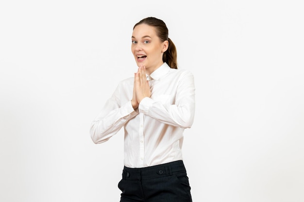 Front view young woman in elegant white blouse just standing on the white background woman office job female worker lady