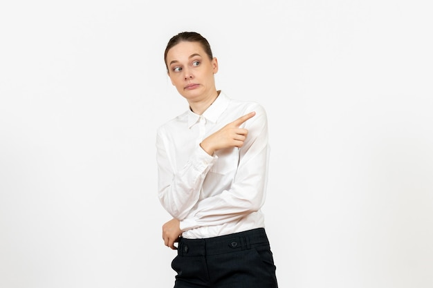 Front view young woman in elegant white blouse just standing on white background woman office job female worker lady
