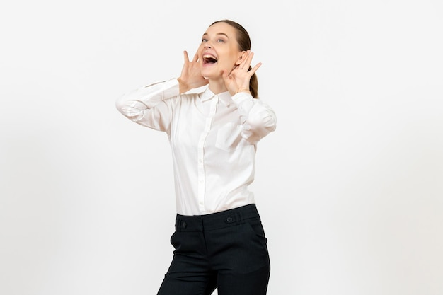 Front view young woman in elegant white blouse laughing on white background woman office job lady female worker