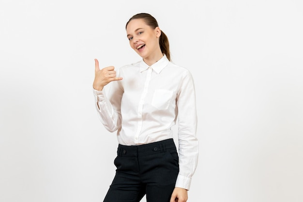 Front view young woman in elegant white blouse posing on white background woman office job lady female worker