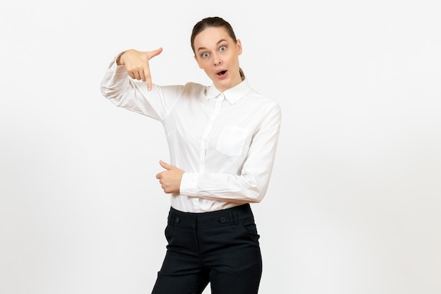 Front view young woman in elegant white blouse with excited face on white background woman office job lady female worker