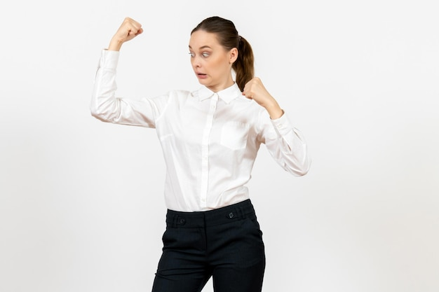 Front view young woman in elegant white blouse with rejoicing face on a white background woman office job lady female worker