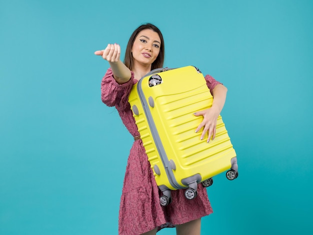 Front view young woman going in vacation and holding big bag on blue background journey sea vacation voyage woman abroad