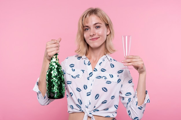 Front view young woman holding champagne at party
