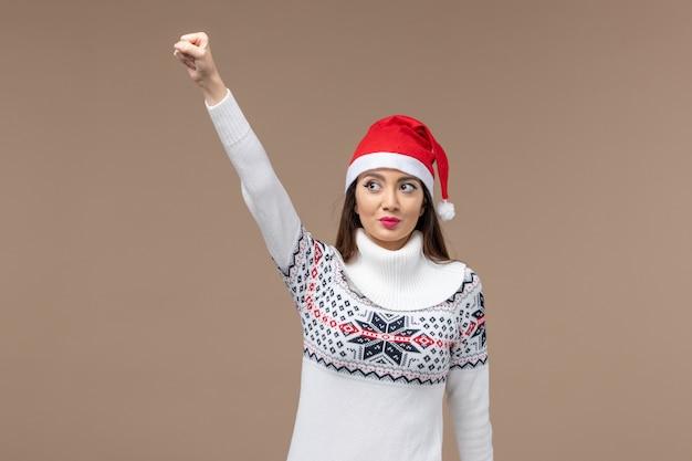 갈색 배경 크리스마스 감정 새 해에 전면보기 젊은 여자